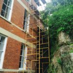 Scaffolding for painting the top cornices