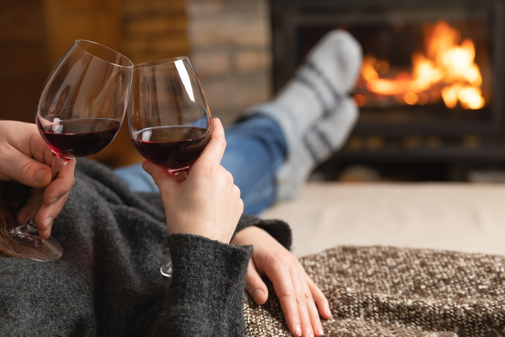 Relax and unwind with a glass of wine by the fire at our Galena Bed and Breakfast one of the most romantic getaways in Illinois